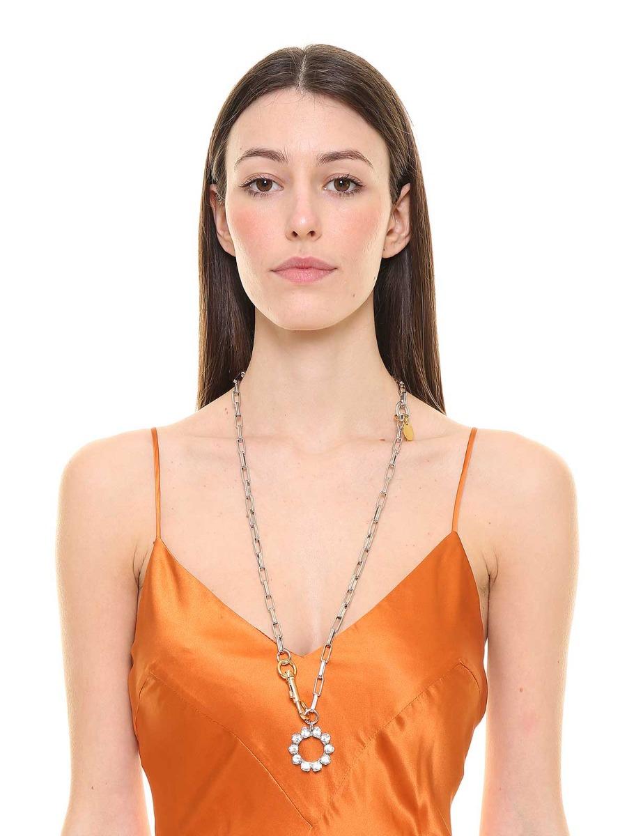 Collana in ottone con pendente geometrico di cristalli