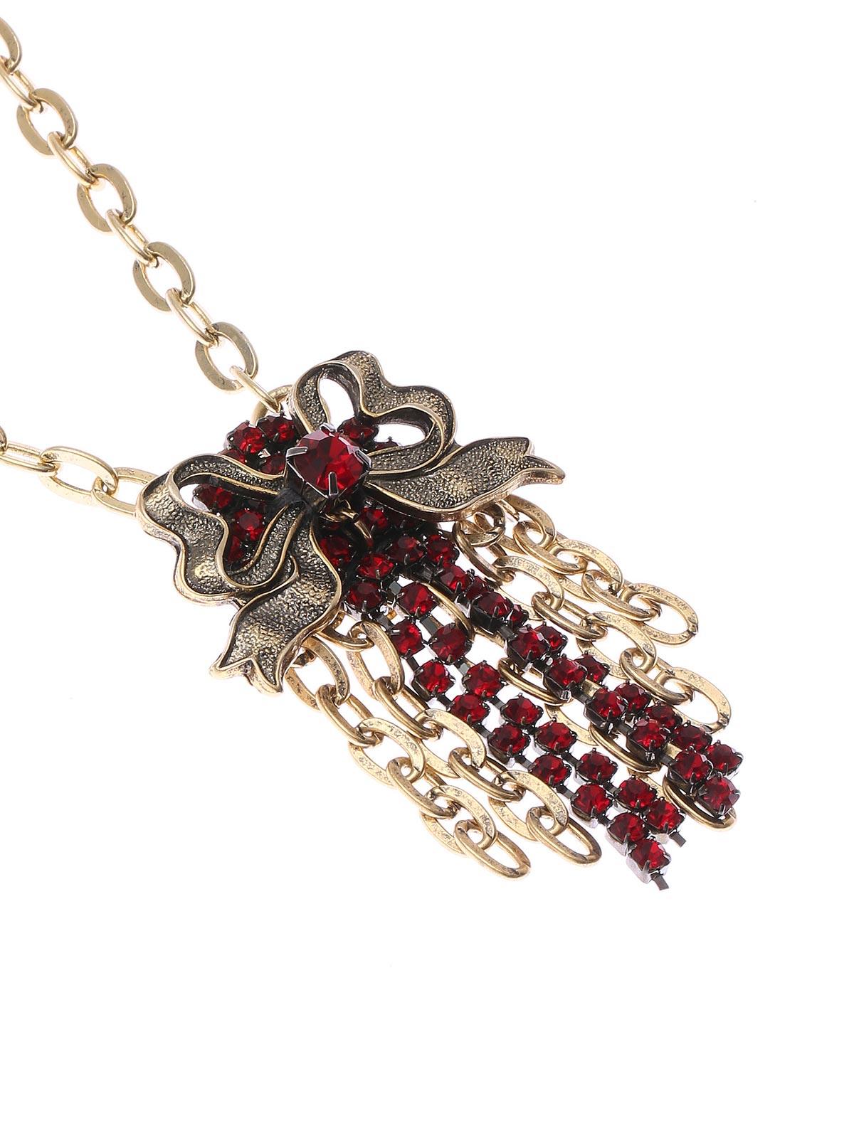 Collana a catena con pendente floreale in ottone