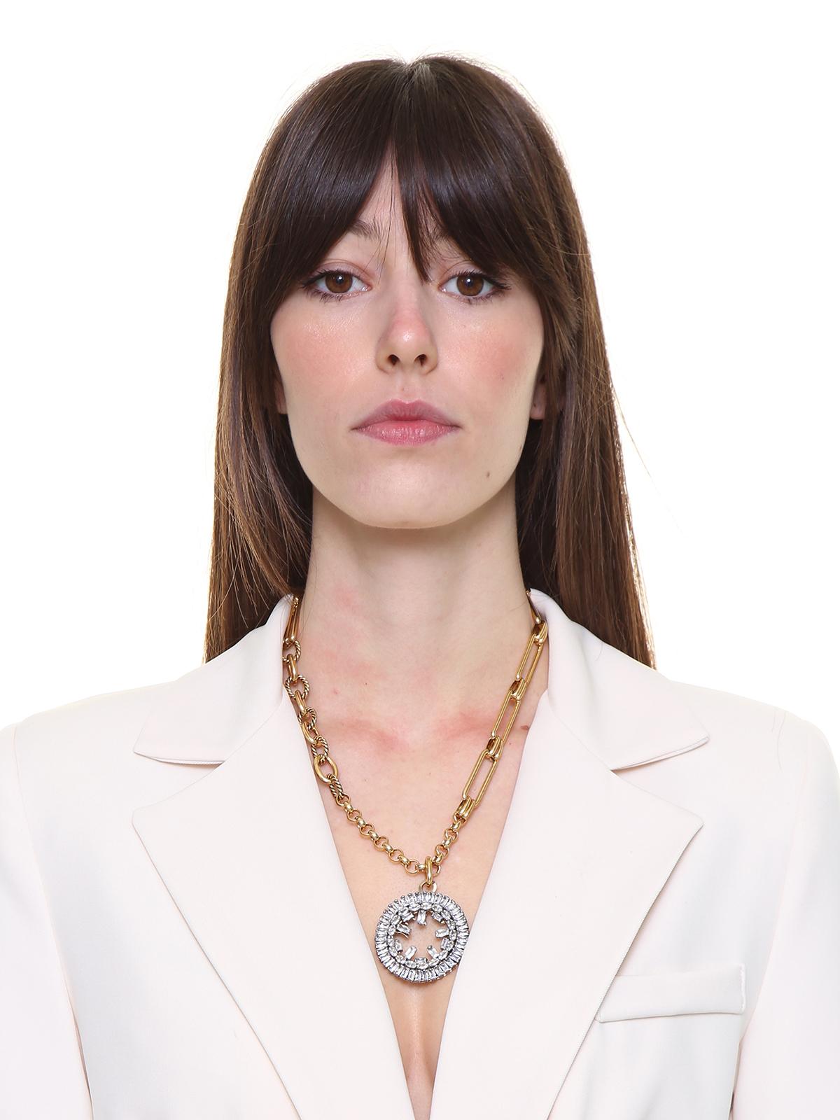 Collana  mix di catene con pendente cerchio gioiello ricamato con baguettes e pietre ovali